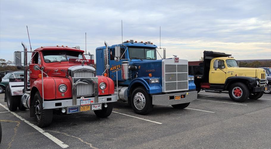 Howard Pratt's 1958 Mack tractor, George Fiebe's 1989 Marmon tractor, & Craig Kenda's 1962 International dump