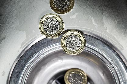 Money Down the Drain.jpg