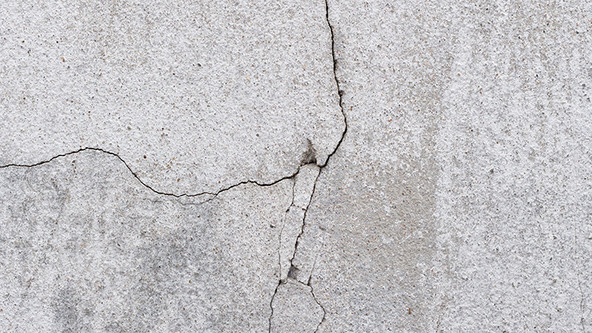 Stucco cracks.