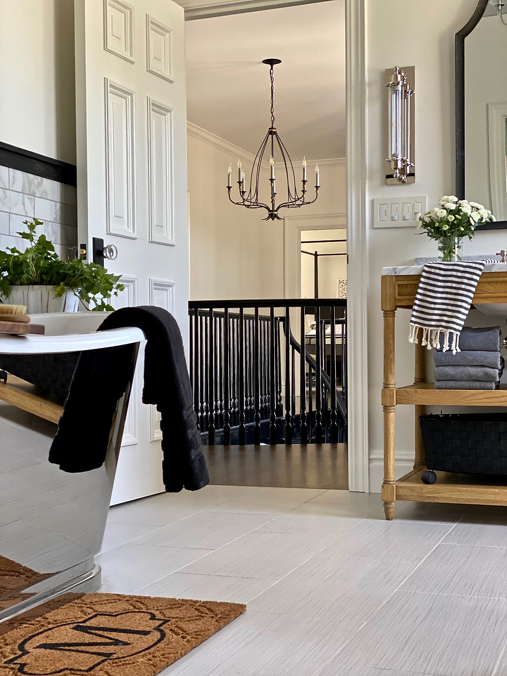 Spa bathroom, black staircase railings, stainless steel tub, spa retreat, bathroom design, black and white bathrooms, beautiful bathroos