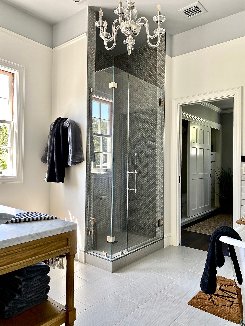 Beautiful bathroom design, bathroom chandelier, high ceilings, herringbone tile,
