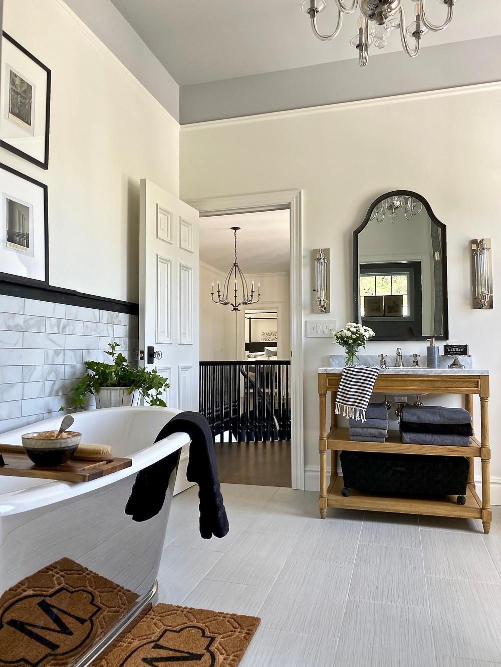 beautiful bathrooms, interior design, bathroom design, vintage bathroom style, gray walls, white dove, vintage art, art wall, black chandelier