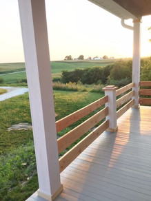 This classic deck rail was built without a top board, creating a charming farmhouse vibe with a modern twist.
