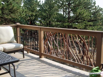 A creative take on a traditional deck railing, this option features branch fencing that lends a rustic touch.