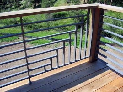 Simple from afar but striking up close, this uniquely fenced deck railing features a pale blue finish.