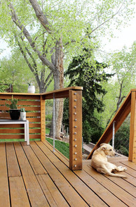 A mix of horizontal wood paneling and a modern cable rail gives this deck a luxury appeal that will stand the test of time.