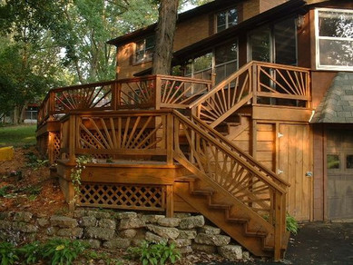 Architectural detail from the sunburst-style railing adds a subtle twist to a traditional deck.