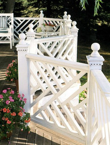 A popular Southern-style railing, this Chinese Chippendale deck is charming and summery.