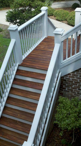 A classic deck railing is given a colorful kick with a pale blue paint job.