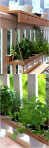 Make the most of your deck railing by installing a tabletop and hanging planter, like this modern wood-and-rope version.
