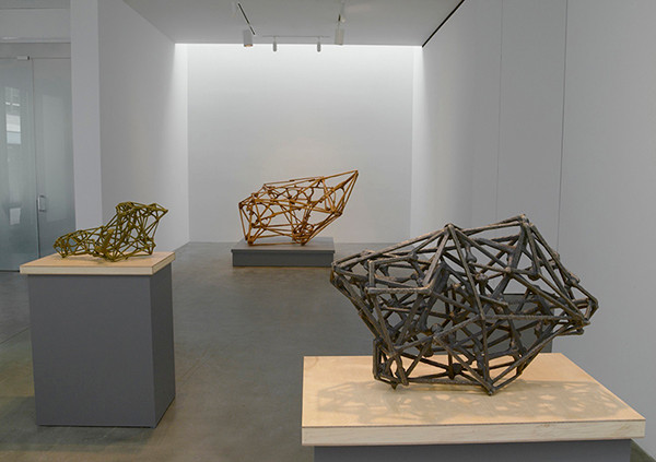 "James Siena, Installation View, (works front to back), ""J.G. Ballard"" (2006 – 2013). Bronze, 9 3/4 × 27 × 18 ̋. ""Ilya Prigogine"" (2011 – 2014). Bronze, 13 3/4 × 29 × 16 3/8 ̋. ""Just Read the Instructions"" (2013). Cherry wood, 47 3/4 × 68 1/2 × 59 3/4 ̋. Photo: Kerry Ryan McFate / Pace Gallery. © James Siena, courtesy of Pace Gallery."