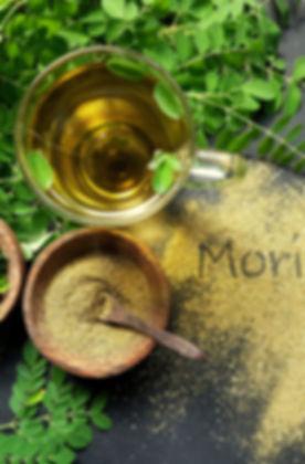 Moringa Oleifera tea with powder on tabl