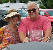 Judy and Aldie with award.jpg