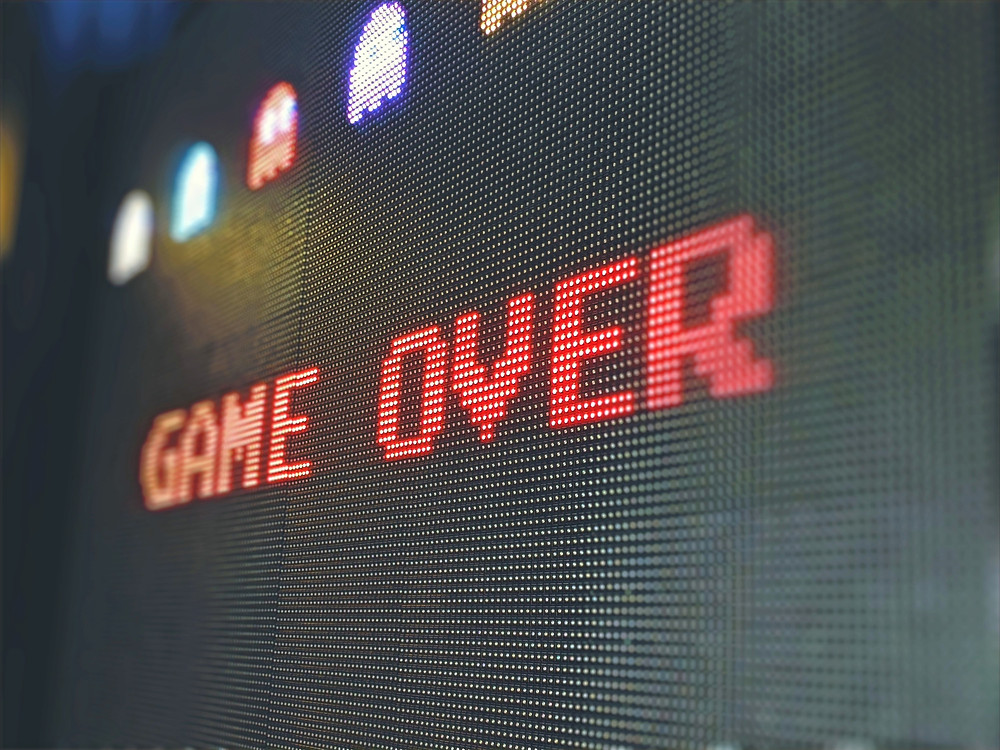 """pixelated text """"game over"""" written on a video game screen"""