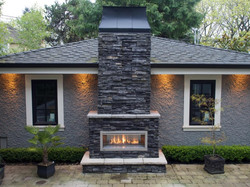 Fireplace facing with cap stones