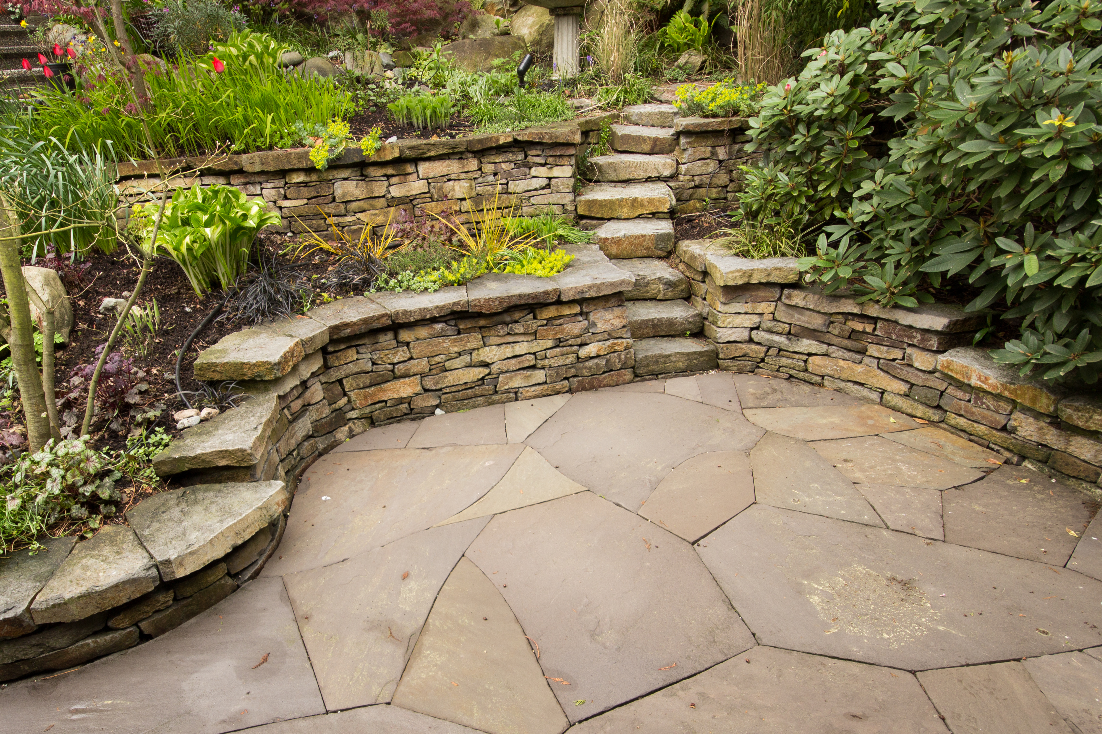 Basalt walls with flagstone patio