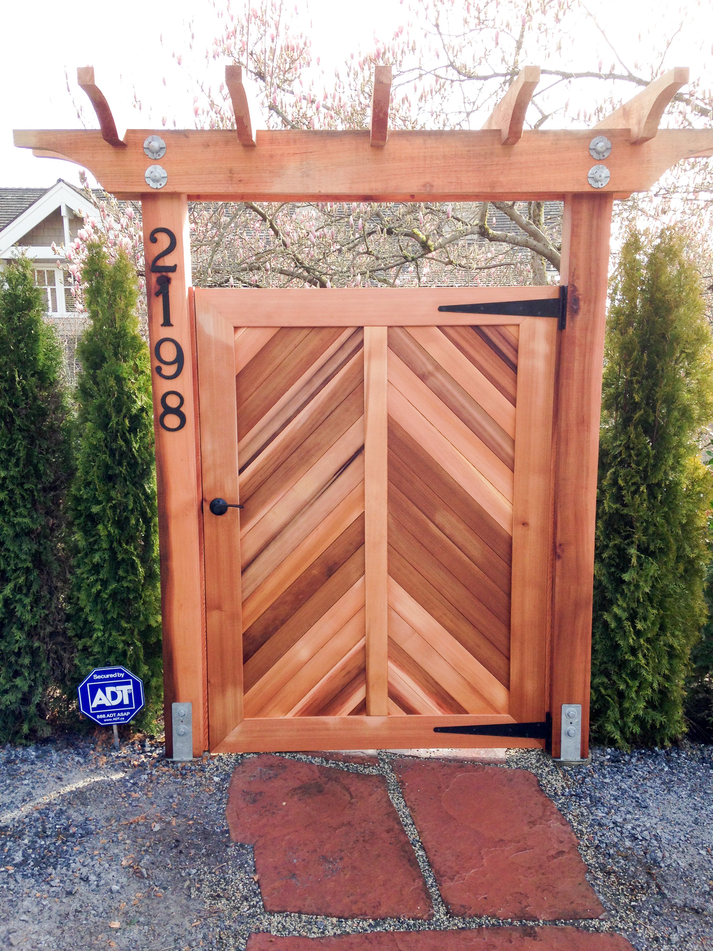 Custom cedar gate with pergola
