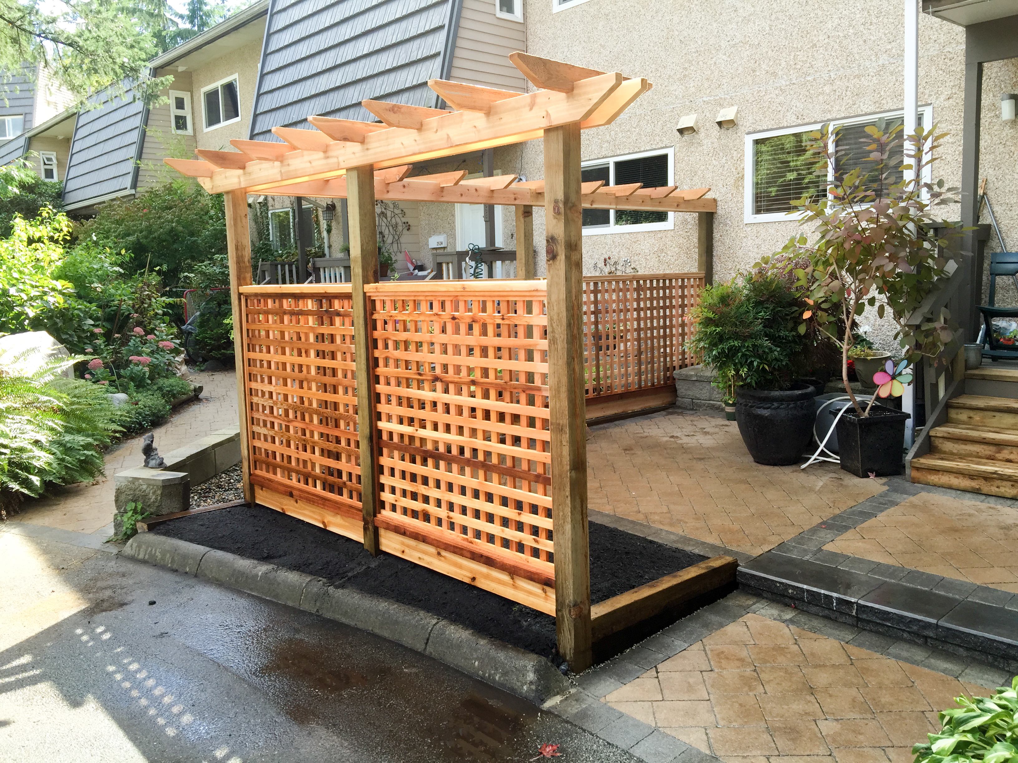 Cedar lattice fence with pergola