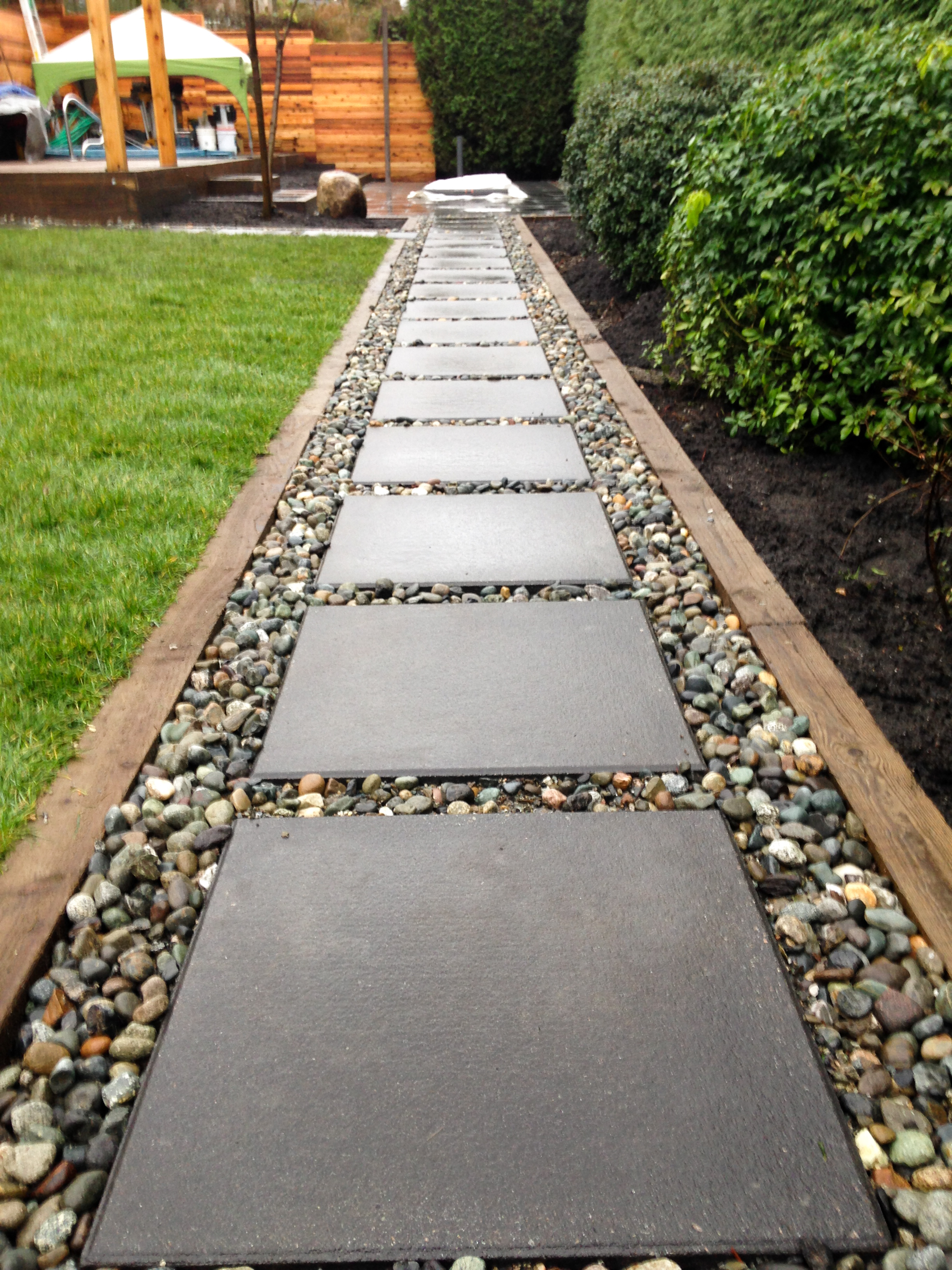 Concrete slab path with river rock
