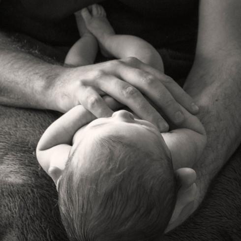 craddled by dad.jpg