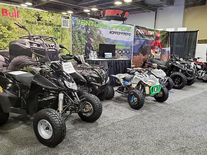 DRR USA Electric ATVs at a trade show