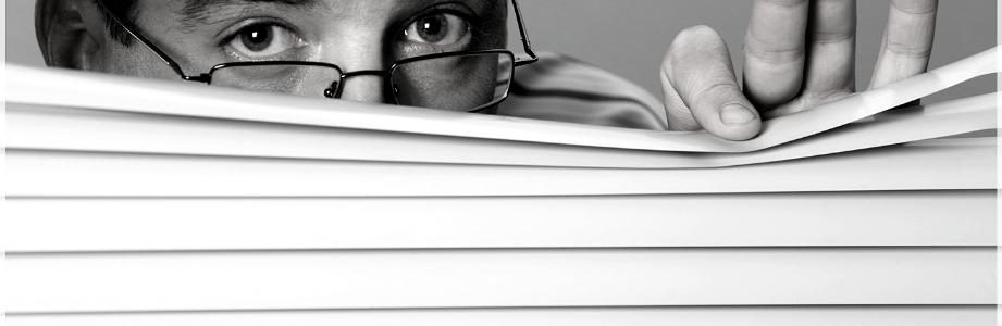 Man spying through office window shades