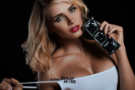 Sexy woman holding Playboy condoms