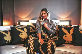 woman and Playboy pillows