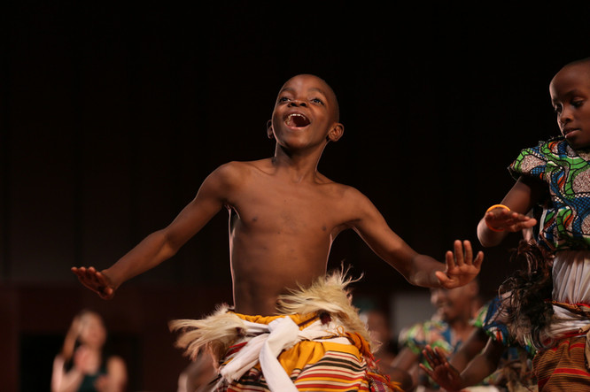 One of many talented young dancers from Uganda, Christopher Moloki, shows his unbridled joy in the performance of At Home in the World in Sendai, Japan.  Atsushi Shibuya for Ashinaga