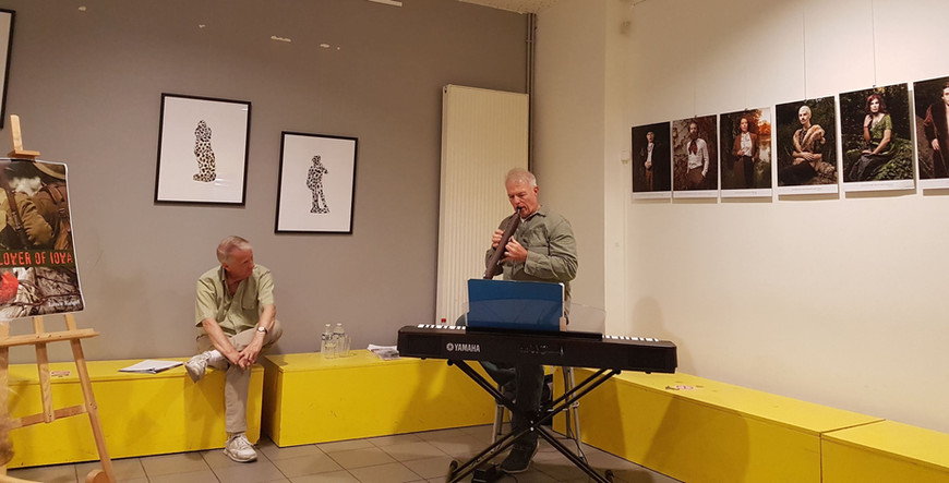 Chuck Muckle performs music from World War I as Lance Ringel looks on during a dramatized reading of Flower of Iowa at the Centre LGBT Paris-Îdf in France. Photo: Andrej Pišl