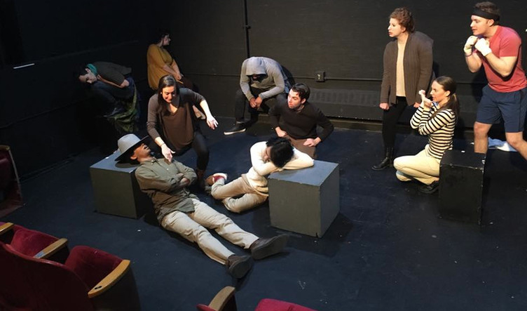 (lower left) The Monkey (Molly Heller) tries to steal the keys from the sleeping zookeeper, Mr. Warden (Marcus Edghill) in the Midtown International Theatre Festival production of Animal Story.