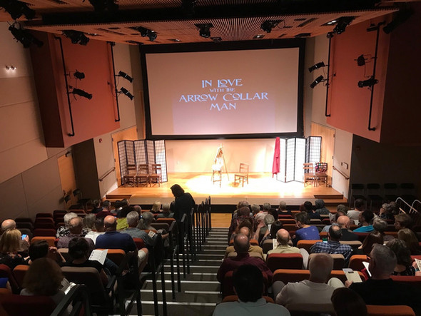 Audience members start to fill the auditorium at Reynolda House prior to a performance of In Love with the Arrow Collar Man.