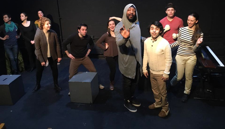 """(foreground)  In the Midtown International Theatre Festival production of Animal Story, the Elephant (LaRon Lee Hudson) sings to the Polar Bear Cub (Zach Bullock) about """"When We Were Free."""""""