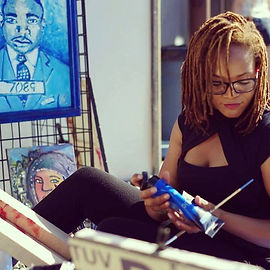 Shonda painting outdoors at Artivist Event.