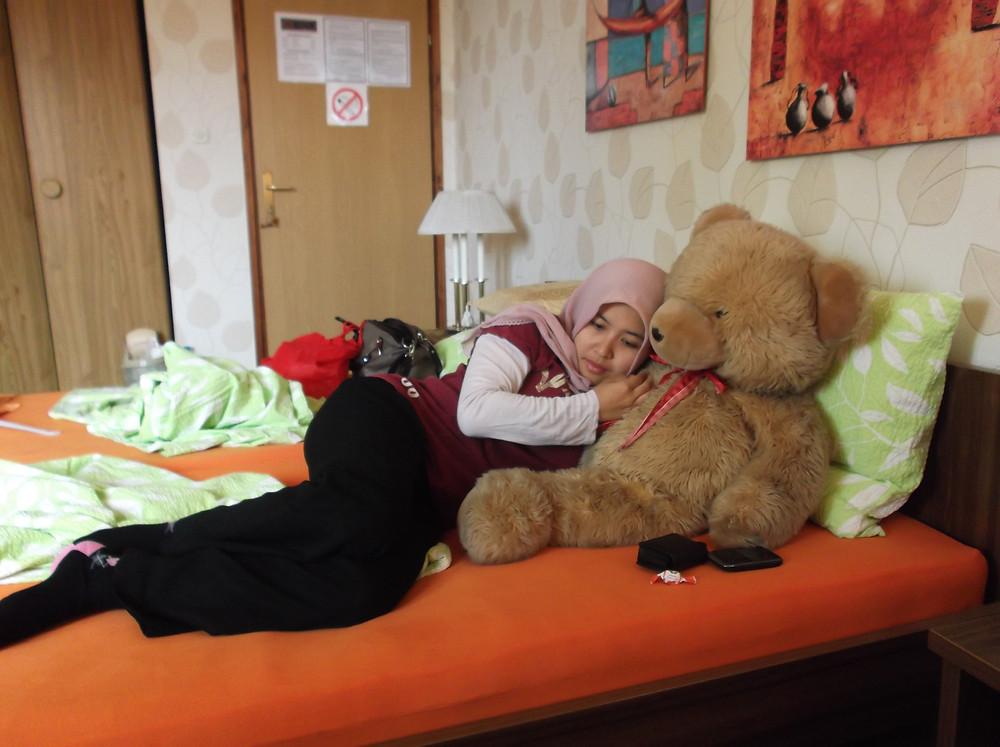 with a giant teddy bear