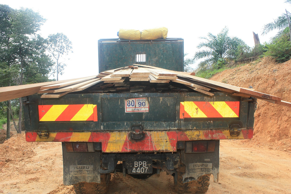 lorry carrying planks
