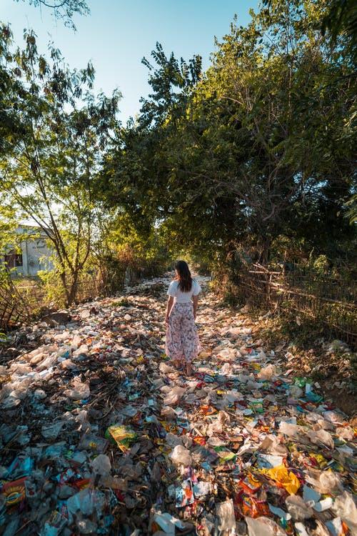 trash-covered road in Myanmar