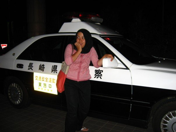 With the police car