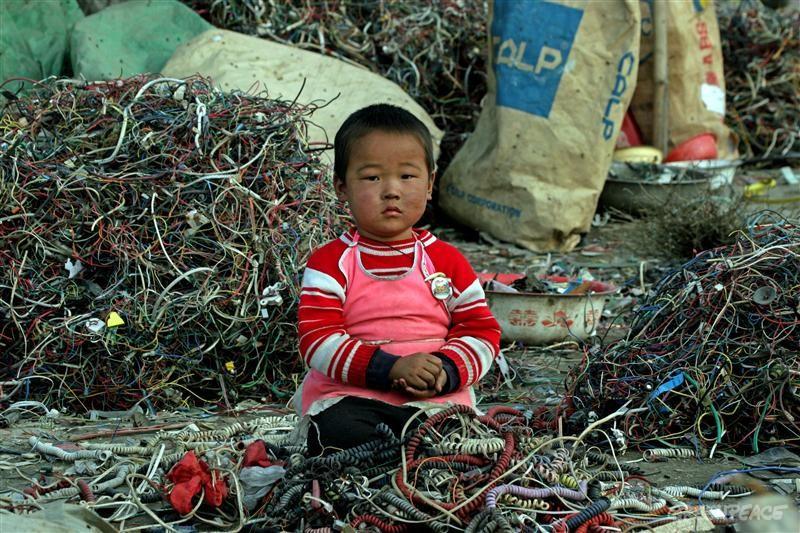 child among e-waste