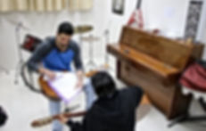 שיעור גיטרה בית הלמיד