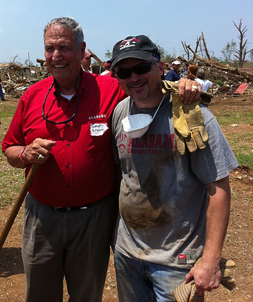 Coach Gene Stallings and LotUSA founder Darryl Fuhrman help with tornado cleanup