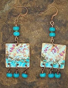blue patina earrings on stone.jpg