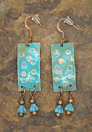 hammered turquoise earrings on stone.jpg