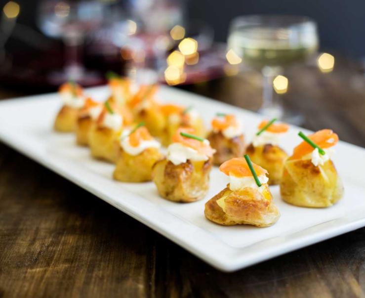 Mini baked potatoes with smoked salmon