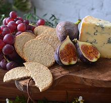 Grazing platter cheeseboard with crackers, grape and fig. Copyrighted - property of Stylish Eats