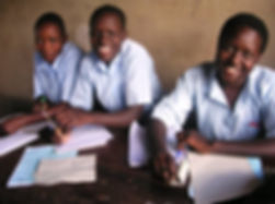 close up girls in Uganda with letters.jp