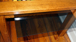glass stores in slot under table