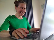 Jodi at work on the laptop.jpg