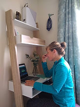 Jodi at new desk working .jpg
