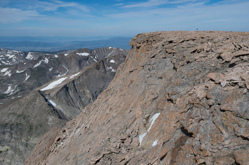 A climber is dwarfed by massive rocks on the summit of  Longs Peak in Rocky Mountain National Park on Friday, July 19, 2017.